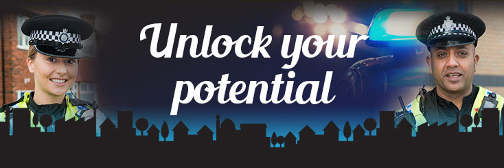 """Two police officers stood either side of words """"unlock your potential"""""""