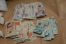 Cash seized during an operation in Bradford on Saturday 10 October